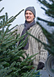 Scarf Man Buying Christmas Tree stock image