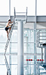 Man Climbing Ladder On Diving Platform stock photography