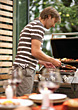 Man Cooking At Barbecue stock photography