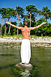 Fitness & Exercise Man Doing Meditation Exercises On The Beach stock photography
