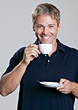 Man Drinking Coffee Smiling stock photo