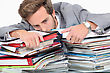 Man Drowning In Stacks Of Paperwork stock photography