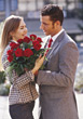 Man Giving Roses stock photo