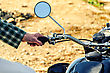 Man's Hand Rests On The Steering Wheel Motorcycle stock photo