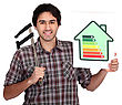 Man Holding Calipers And Information About Energy Efficiency stock photo