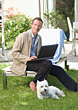 Man In Backyard on Laptop stock photo