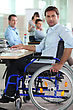Smallgroup Man In Wheelchair On Laptop stock photo