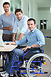 Man In A Wheelchair Pictured With Colleagues stock image