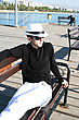 Man In White Hat On The Pier. stock photo