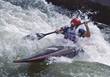 Man Kayaking in Rapids stock photography