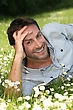 Man Lying In A Field stock photography