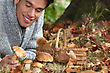 Man Lying On The Floor Picking Mushrooms stock photography