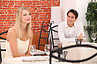 Man Observing Pretty Lady In A Restaurant
