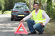 Man Putting Out A Hazard Triangle stock image