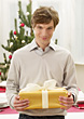 Man Receiving Present stock photography