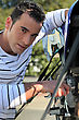 Man Repairing Motorcycle stock photography