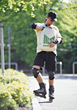 Man Shopping on Rollerblades stock photo