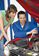 Man Showing Woman Car Repair stock photography