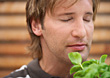 Man Smelling Herbs With Eyes Closed stock photography