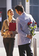 Man Suprising Woman With Roses stock image