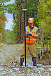 Man Surveying The Location Of Geophones For A Seismic Reflective Survey On The West Coast Of New Zealand