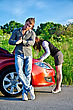 Man Is Waiting His Girlfriend Repairs A Broken Car stock photography