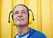 Loud Man Wearing Hearing Protection stock photography