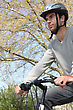 Man Wearing A Helmet On His Bicycle stock photo