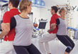 Man & Woman Exercising Looking In Mirror stock photo