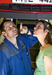 Car Mechanics Man & Woman Looking Underneath Car Repair stock photo