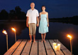 Man & Woman Standing At End Of Pier