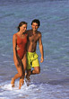 Man and woman walking arm in arm at the beach stock image