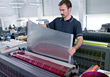 Man Working With Printing Press stock photo