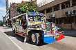 MANILA, PHILIPPINES - FEBRUARY 24: Jeepney On The Street On February, 24, 2013, Manila, Philippines. Jeepneys Are The Most Popular Means Of Public Transportation In The Philippines