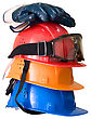 Many Colored Hardhats, Gloves And Goggles With Reflection stock photo