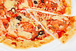 Meat Pizza Closeup With Carbonado Ham, Tomato, Olive And Mozzarella Cheese stock photography
