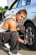 Mechanic Fixing A Tire On A Road stock photo