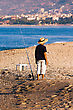 Mediterranean Coast Of Turkey, The Fisherman Behind Work stock photo