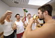 Men Celebrating In Locker Room stock photo