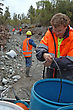 Men Collect In Microphone Cables Used For Seismic Test, Westland, New Zealand stock image