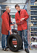 Men In A Tire Shop stock photo