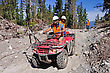 Men Use An All Terrain Vehicle For Setting Out Cables In A Seismic Reflective Survey
