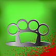 Metal Brass Knuckle And Drops Of Blood On Green Background