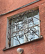 Metal Forged Carved Lattice At A Plastic White Window stock photography