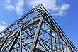 Metal Frame With Safety Net Against A Background Of Blue Sky With Clouds stock image