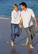 sand beaches walking dressed couple fun stock photo
