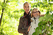 Middle-aged Couple Walking Through Park stock photography