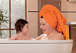 Mom and Baby Taking a Bath stock image