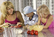Mom and Kids Preparing Food stock photography