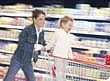 Motion Mom and Son Grocery Shopping stock photography